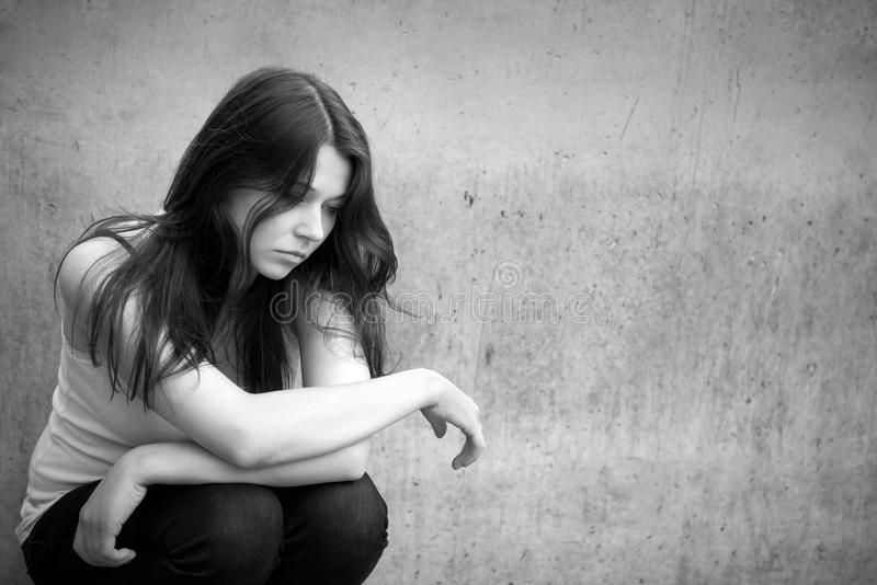 Teenage girl looking thoughtful about troubles royalty free stock photos