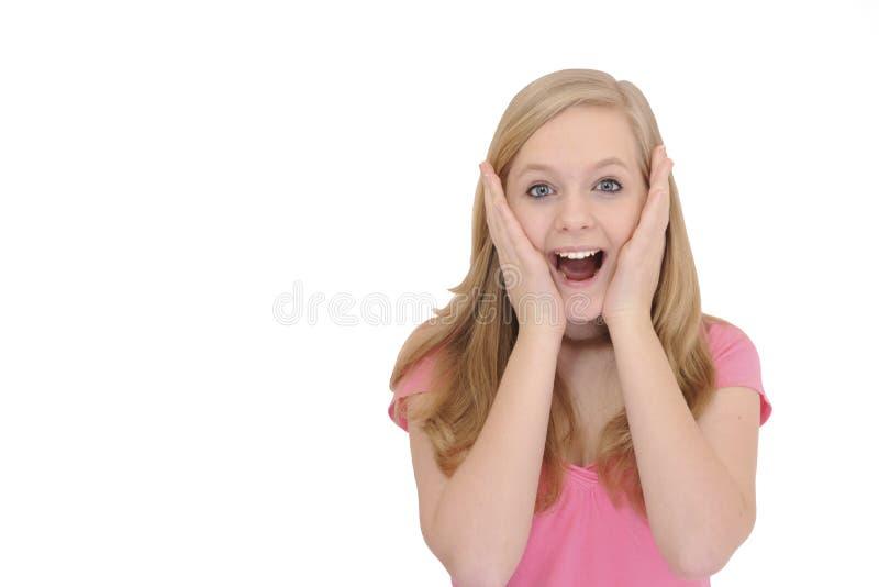 Teenage girl lshowing surprise royalty free stock photo