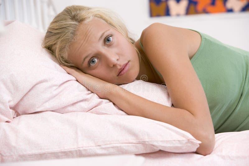 Teenage Girl Lying On Her Bed stock photography