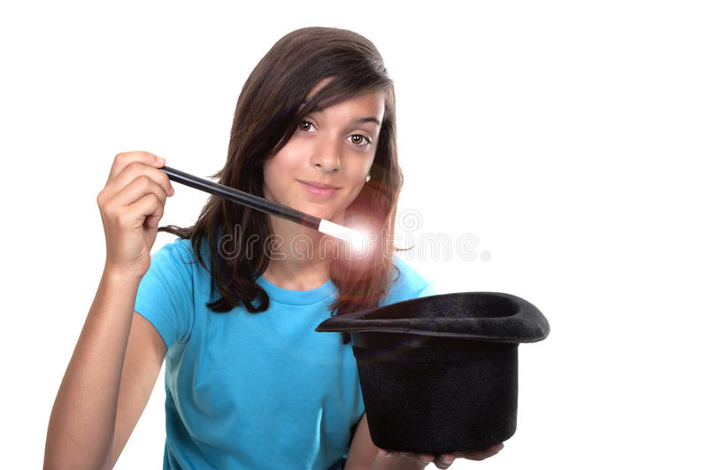 Teenage girl with magic wand and hat stock photography