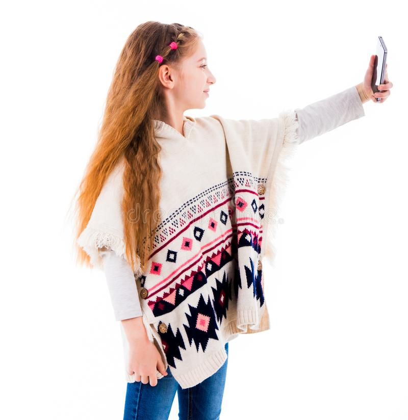 Teenage girl making a selfie stock image
