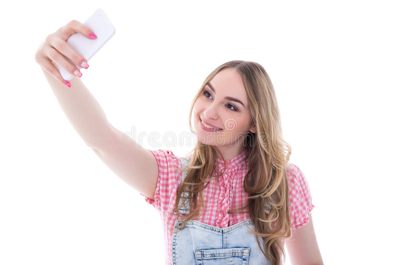 Teenage girl making selfie photo on smart phone isolated on whit royalty free stock image