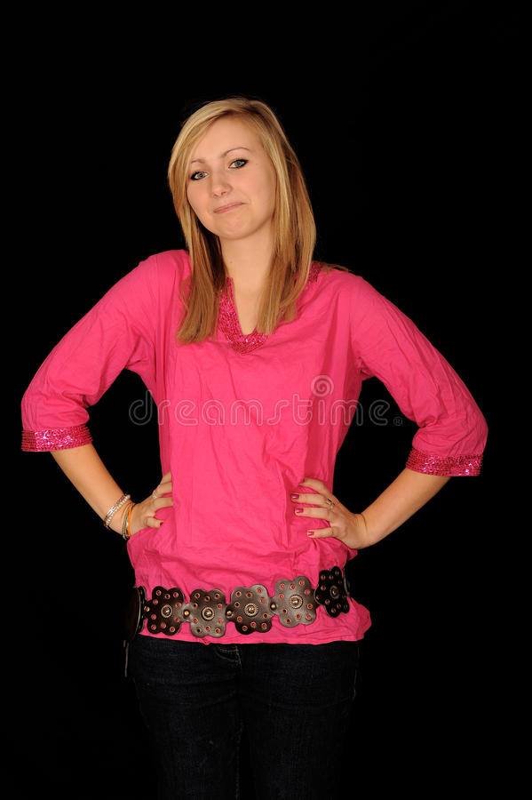 Teenage girl model. A teenage girl model in a pink shirt stock images