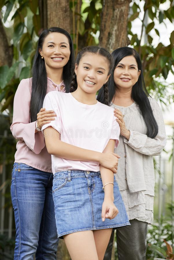 Teenage girl with mother and grandmother stock photos