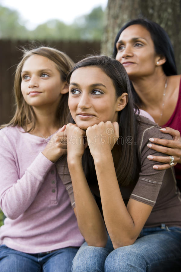 Teenage girl with mother and younger sister royalty free stock photo