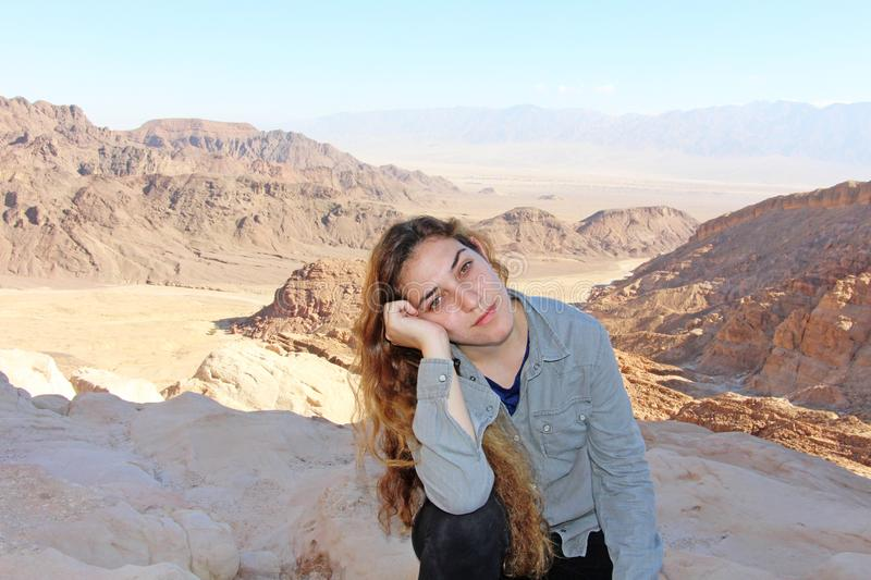 A teenage girl in the Negev desert, near Eilat, Israel. A teenage girl with a tired look on the trip, in the Negev desert, near Eilat, Israel stock images