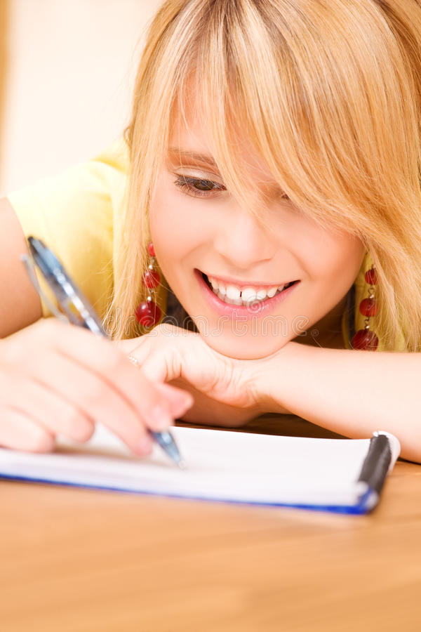 Teenage Girl With Notebook And Pen Stock Images