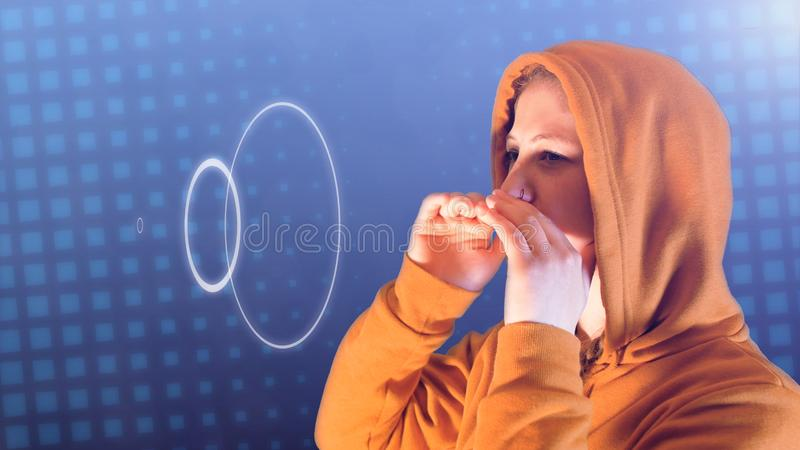Teenage girl, with orange hoodie and sweatshirt, screams sound waves, ideal footage to represent social bullying stock photo