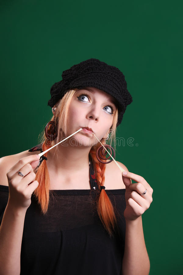 Teenage girl playing with a chewing gum royalty free stock photo