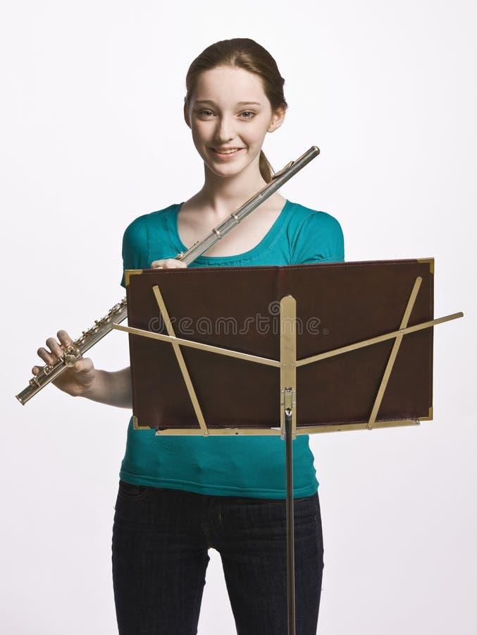 Download Teenage girl playing flute stock photo. Image of girl - 17048414