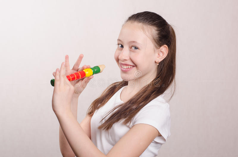 Teenage girl playing the flute royalty free stock photo