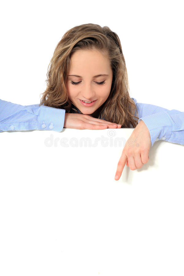 Teenage girl points down blank white sign stock photos