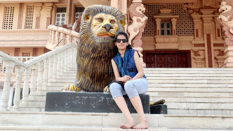 Teenage girl portrait enjoying summer holiday in Delhi temple in India. stock photography