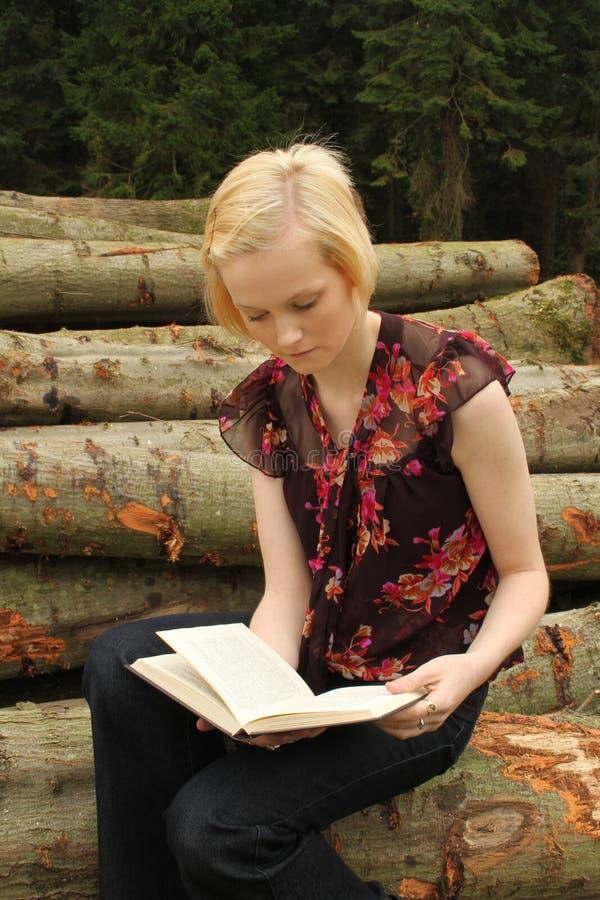 Teenage girl reading outdoors stock photos