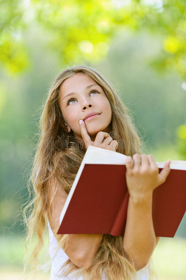 Download Teenage Girl Reading Red Book Stock Image - Image of american, nature: 26591361