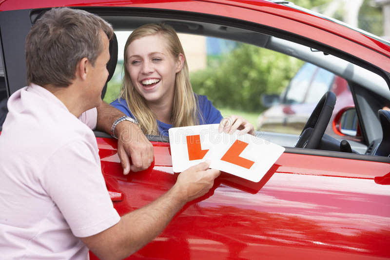 Download Teenage Girl Receiving Her Learner Plates Stock Photos - Image: 7876783
