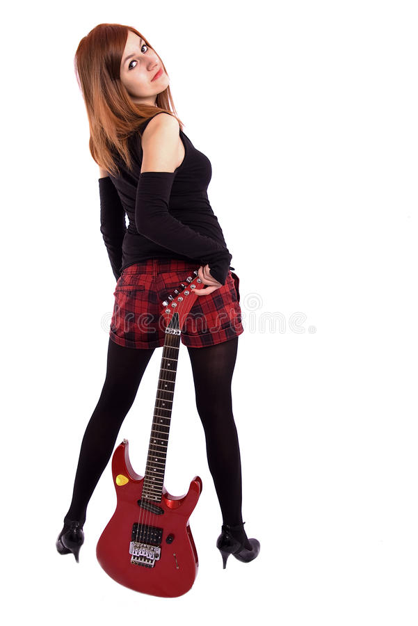 Teenage girl with a red electric guitar stock photo