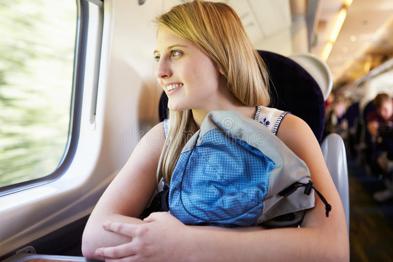 Teenage Girl Relaxing On Train Journey stock images