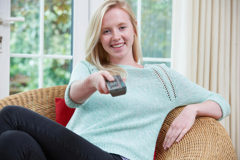 Teenage Girl Relaxing And Watching TV At Home royalty free stock photography