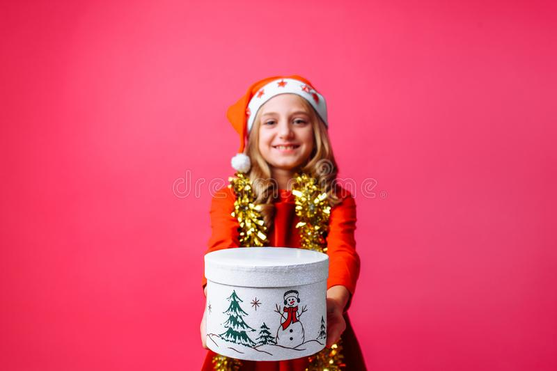 A teenage girl in Santa`s Christmas hat and tinsel around her ne stock images