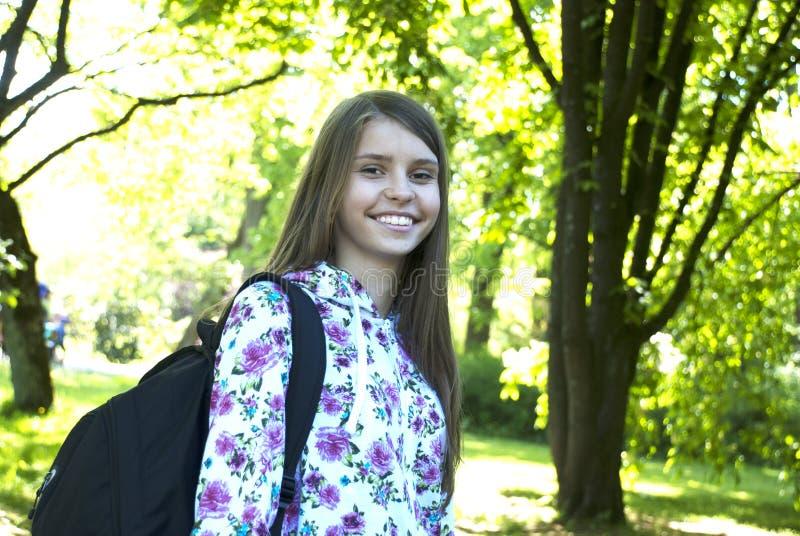 Teenage girl with school bag. stock photo