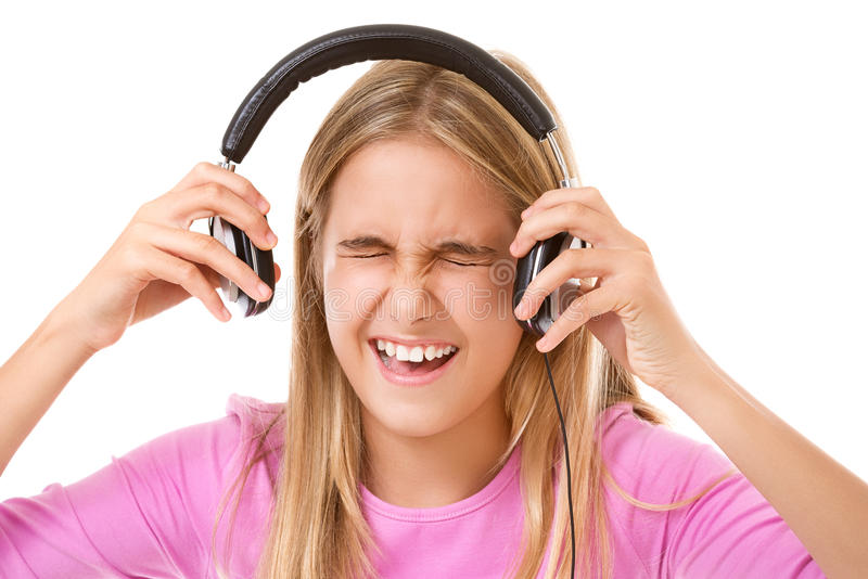 Teenage girl screaming with headphones isolated royalty free stock photos