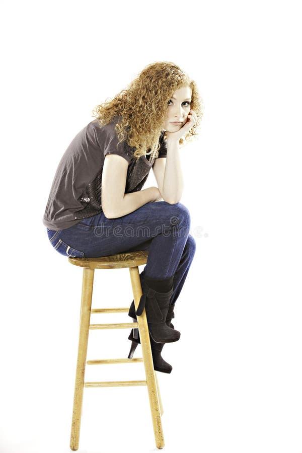 Download Teenage Girl Seated On Stool Stock Photo - Image: 22545818
