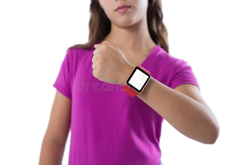 Teenage girl showing her smartwatch against white background stock photography