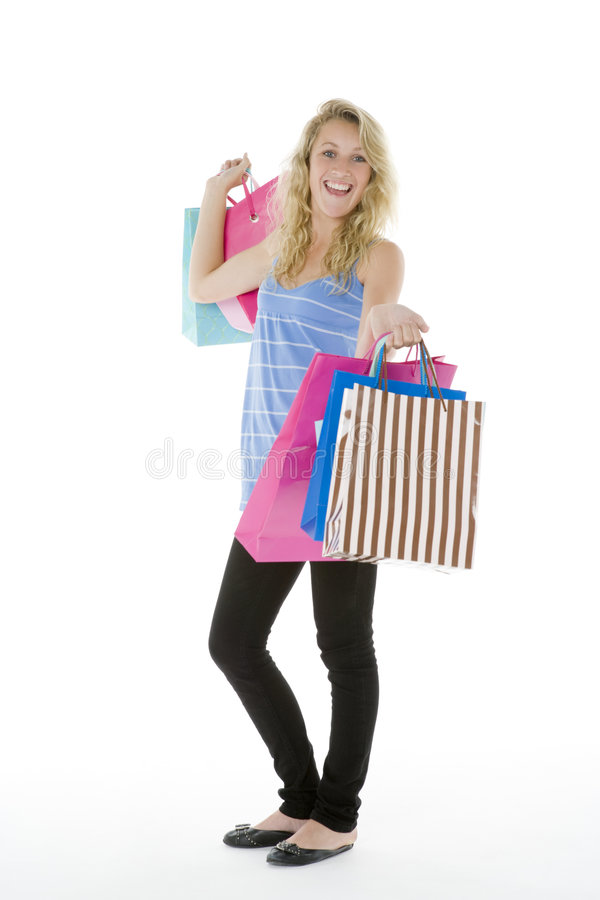 Teenage Girl Showing Off Her Shopping Stock Photography