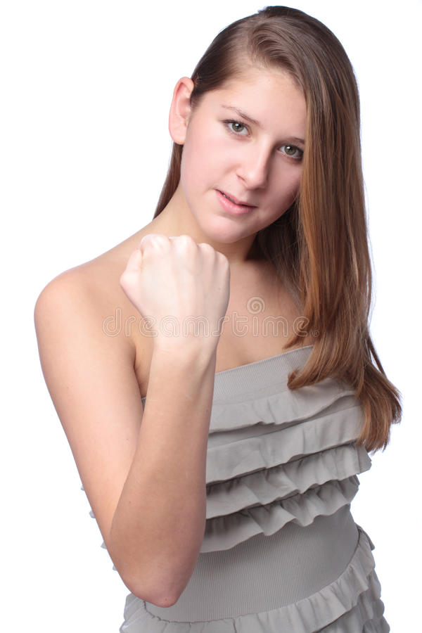 Teenage girl shows a fist. On white background stock images