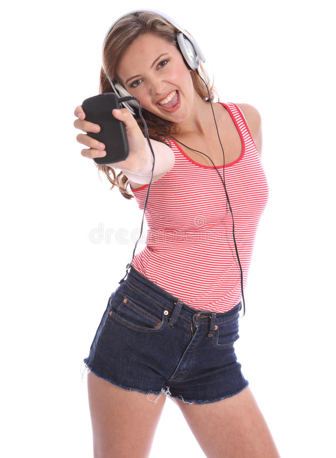 Teenage girl singing to music from her cell phone royalty free stock photos