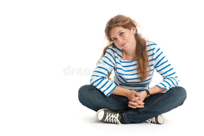 Teenage girl sitting stock photos