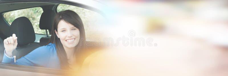 Teenage girl sitting in car holding keys royalty free stock images