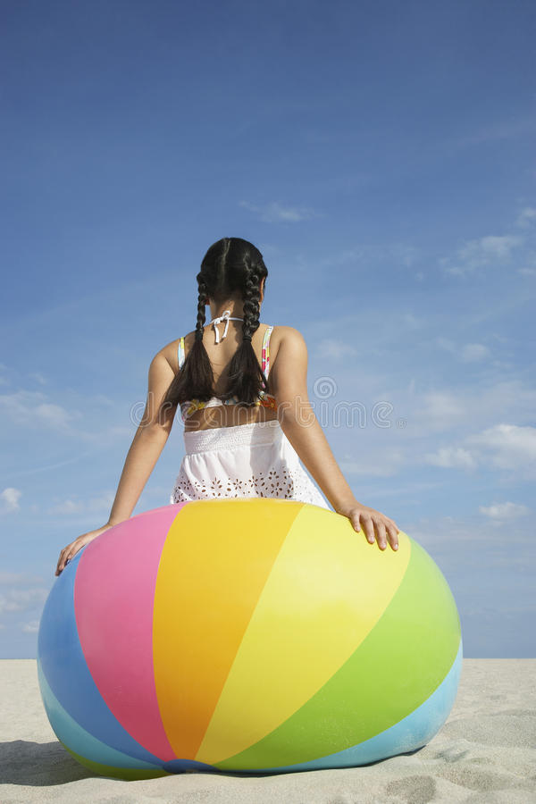 Free Teenage Girl Sitting On Beach Ball Royalty Free Stock Photo - 33894255