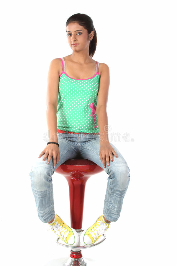 Free Teenage Girl Sitting On Chair Royalty Free Stock Image - 13375966