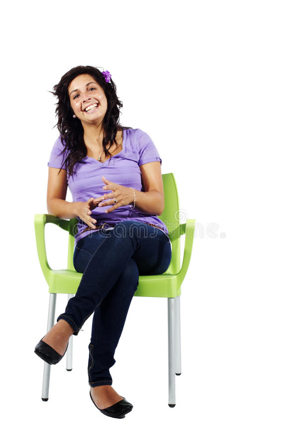Free Teenage Girl Sitting On Chair Laughing Stock Images - 19919794