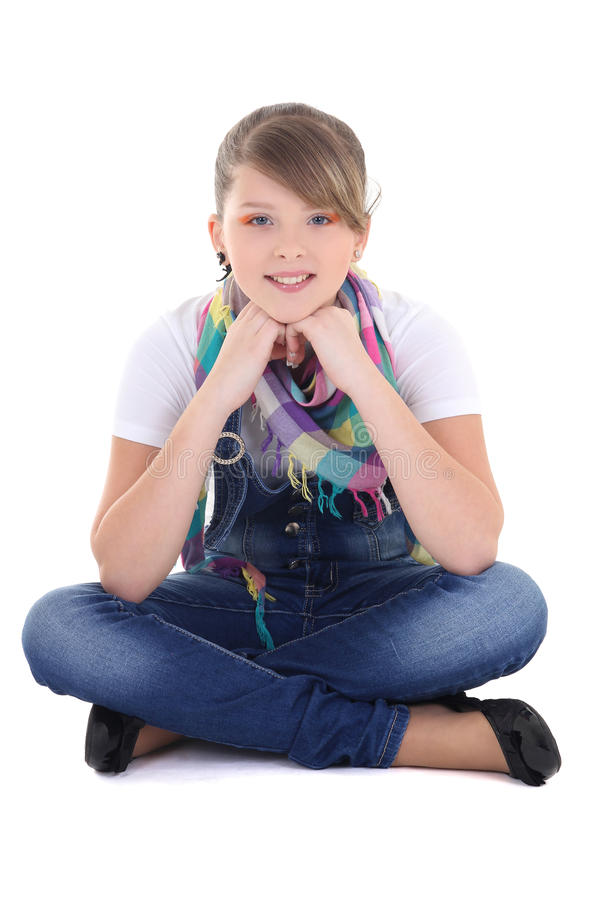 Teenage girl sitting over white royalty free stock photography