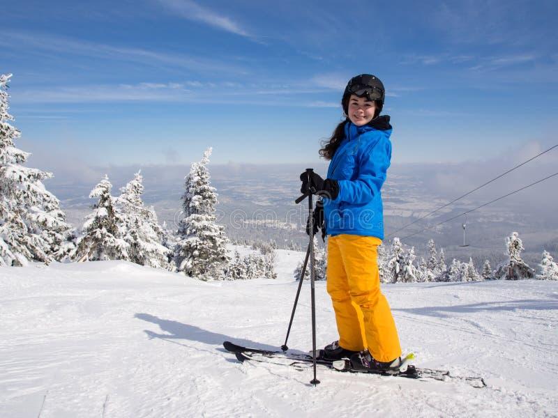 Teenage girl skiing stock image