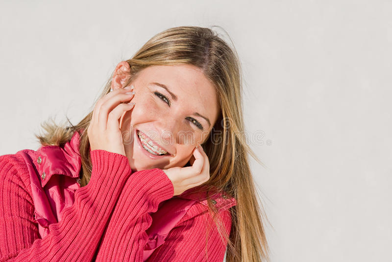 Teenage Girl Smiling. Pretty Teenage Girl Smiling Dressed in Pink stock image