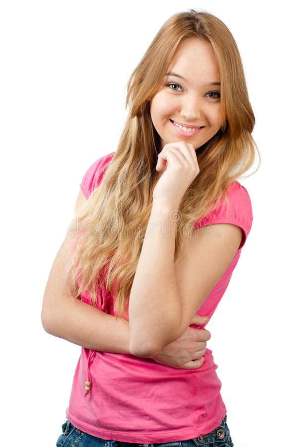 Teenage girl smiling. Beautiful teenage girl smiling and looking into the camera, hand under her chin. Isolated on white background stock photo