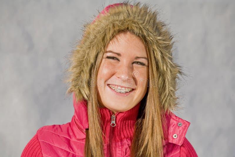 Teenage Girl Smiling. Teenage Girl Wearing Winter Garb and Smiling royalty free stock images