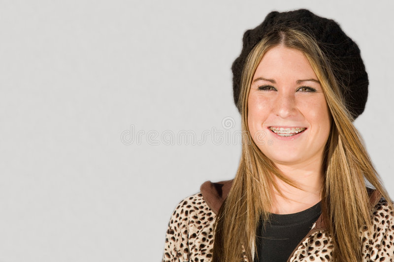 Teenage Girl Smiling. Teenage Girl Wearing Hat and Scarf and Smiling stock photography