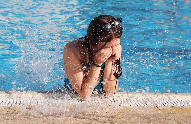 A teenage girl spends in the pool stock photography