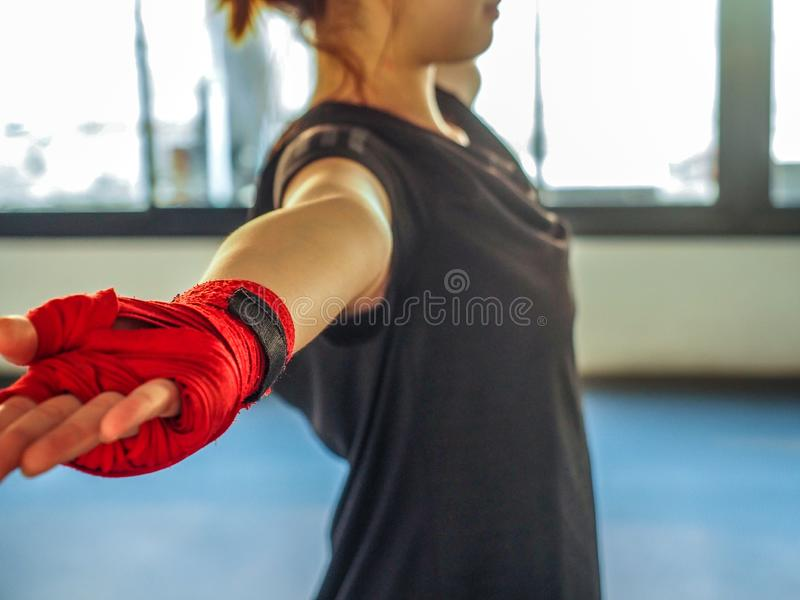 Teenage girl in sports clothes holding a dislocated shoulder on training.  royalty free stock image