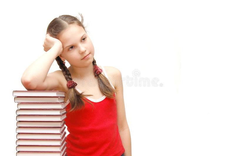 Teenage girl with stack of books stock photos