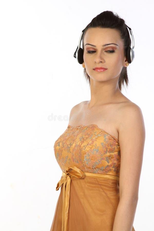 Download Teenage Girl Standing With Headphones Stock Photo - Image: 14814872