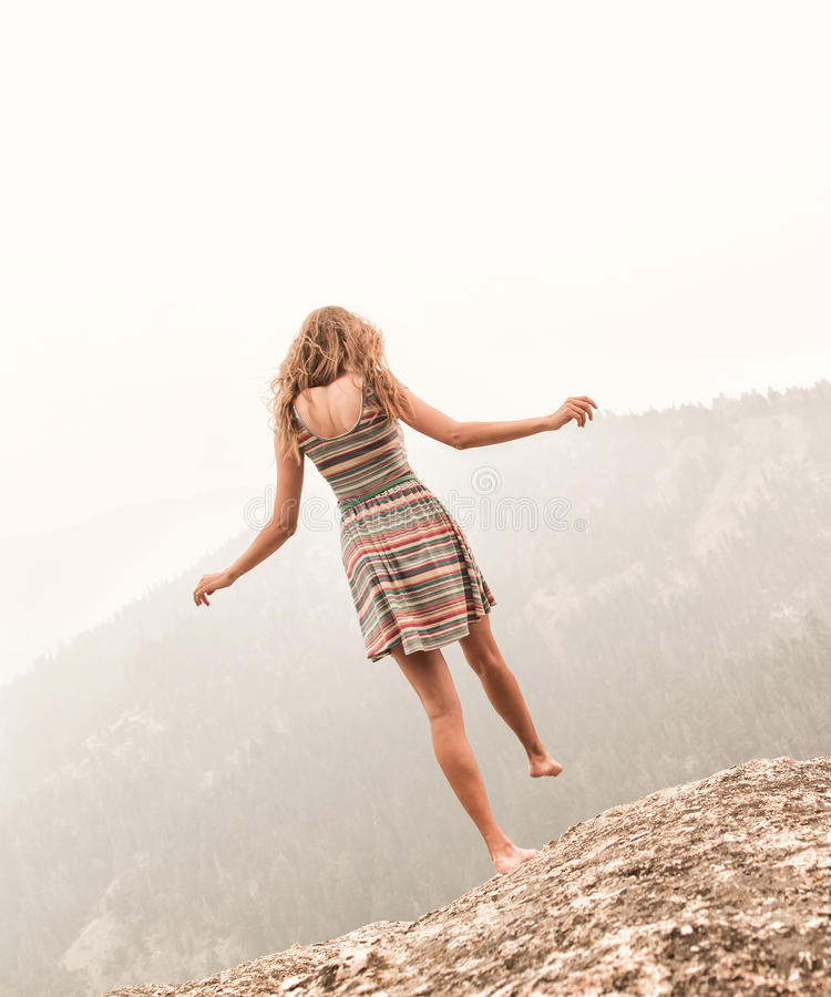 Teenage girl standing on one leg royalty free stock images