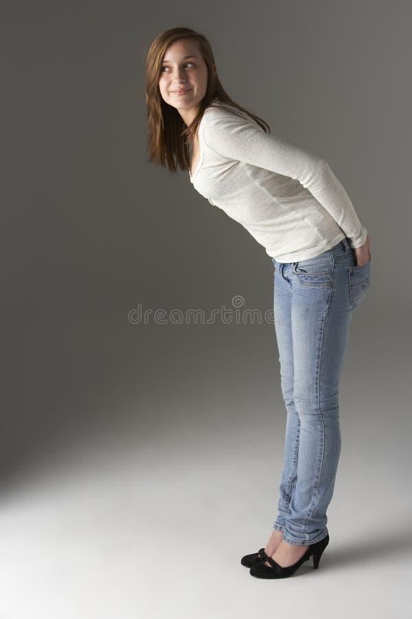 Teenage Girl Standing In Studio royalty free stock image