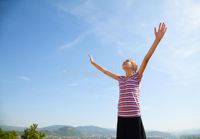 Download Teenage Girl Staying With Raised Hands Stock Photo - Image: 25983018