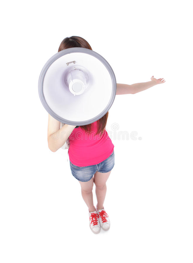 Girl student shouting through megaphone. Teenage girl student shouting through megaphone in full length, isolated on white background, high angle view, asian stock image